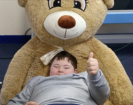 Boy and teddy Care facility days thumbnail Sensory Solutions Holistic audio Bournemouth UK